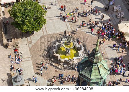 GDANSK, POLAND - JULY 13, 2017: Fountain of the Neptune on the Long Lane of the old town in Gdansk, Poland. Gdansk is the historical capital of Polish Pomerania.