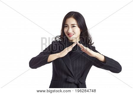 young asian real estate agent showing a roof sign studio shot isolated on white background.