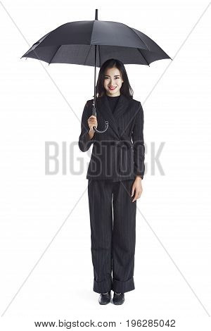 young asian businesswoman holding a black umbrella looking at camera smiling studio shot isolated on white background.