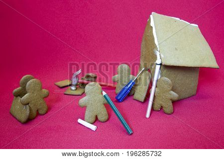 Gingerbread Men Making House On Red