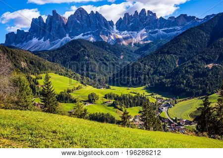 Dolomites, Val de Funes valley. Lovely  day in Naturpark Puez-Odle. Odle mountain peaks around the green alpine meadows of the valley
