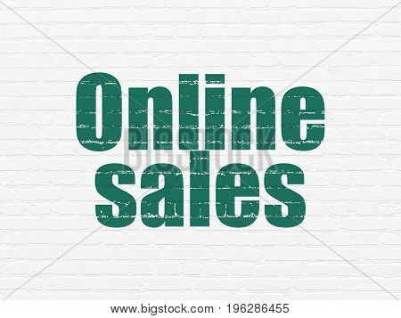 Advertising concept: Painted green text Online Sales on White Brick wall background