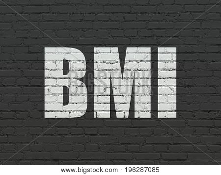 Medicine concept: Painted white text BMI on Black Brick wall background