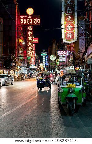 Yaowarat, Bangkok, Thailand - June 6, 2016: Tuk Tuk Taxi parking for passengers at night in Yaowarat, Chinatown.