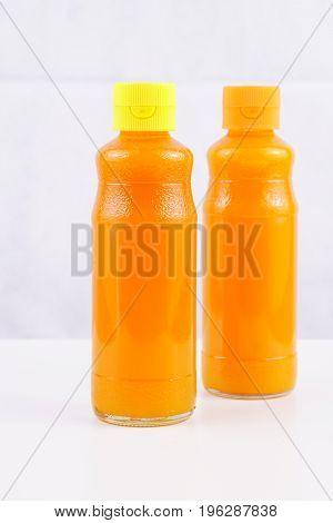 Orange juice and mango juice glass bottle. Isolated on white background