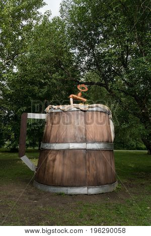 A huge wooden beer mug in the city park.