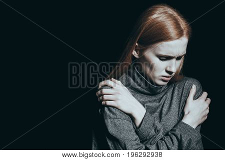 Girl is struggling against an overwhelming hopelessness