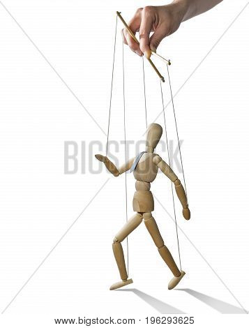 Puppet in the hands of puppeteer walks on isolated white background. Puppet is presented in business style with a tie.