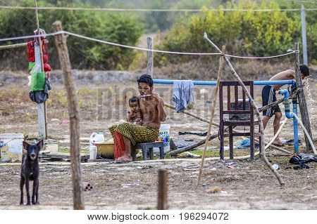 Siem reap Cambodia March 18 2016: Cambodian family in the countryside during morning hygiene