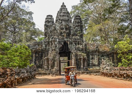 Siem Reap Cambodia March 18 2016: Tourists visiting Angkor Wat riding a tuk tuk in Cambodia