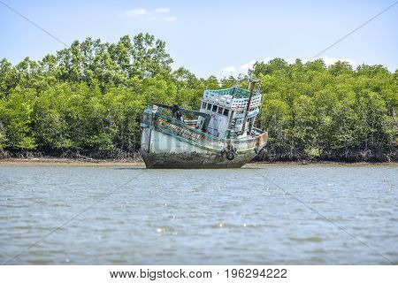 Krabi Thailand March 7 2016: Old abandoned ship aground.