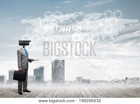 Businessman with camera instead of head and media user interface on screen