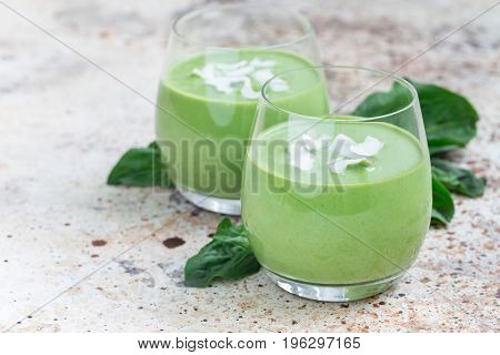 Vanilla mint spinach and coconut milk detox green smoothie in glass horizontal copy space