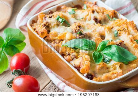 Ziti bolognese in baking dish pasta casserole with minced meat tomato sauce and cheese horizontal