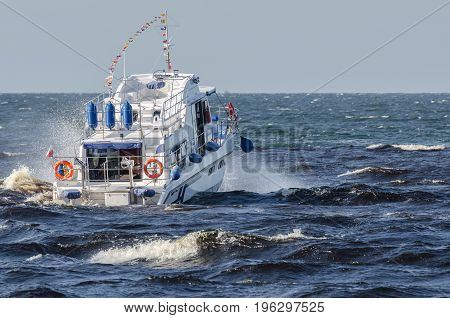 SMALL SHIP - A sea recreational vessel on a cruise
