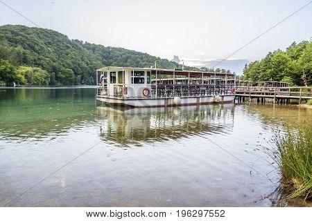 CROATIA PLITVICE, 28 JUNE 2017: Pleasure boats on the pier in the Plitvice Lakes national park.