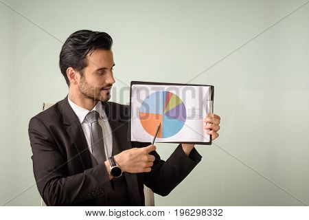 professional caucasian businessman present financial performance chart
