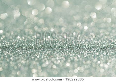 Silver glittering christmas lights. Blurred abstract holiday background