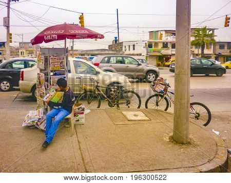 GUAYAQUIL, ECUADOR, NOVEMBER - 2016 - Newspaper street seller vendor at main avenue in Guayaquil outskirts Ecuador