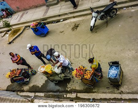 GUAYAQUIL, ECUADOR, NOVEMBER - 2016 - High angle view of typical street food vendors around stadium in Guayaquil Ecuador