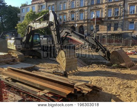 LVIV UKRAINE - MAY 17: Construction machinery during the major overhaul of the road in Lychakivska Street in Lviv on May 17 2017 in Lvov Ukraine