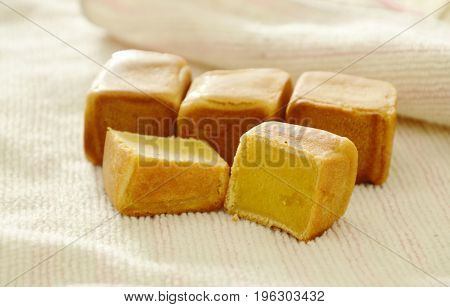 Chinese square pasty stuffed mush sweet bean on cloth