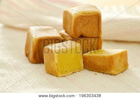 Chinese dice cake stuffed mush sweet bean on cloth