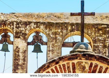 A painted cross at an old Spanish mission in southern California.