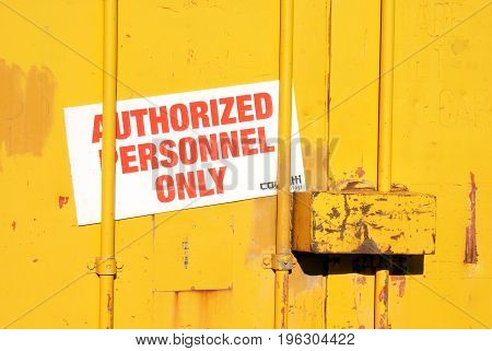 Closeup view of an authorized personnel only sign.