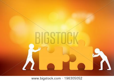 Business Creative and Teamwork Concept : Two person trying to connect couple jigsaw puzzle piece with sunlight background.