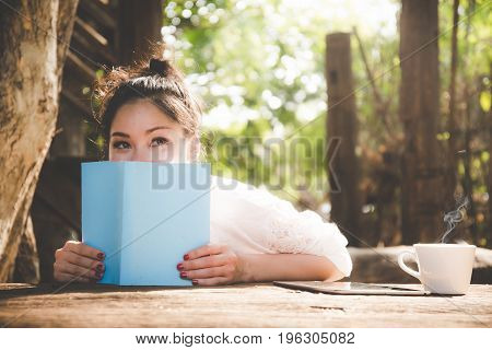 Relaxation woman drink coffee and reading laptop in the park