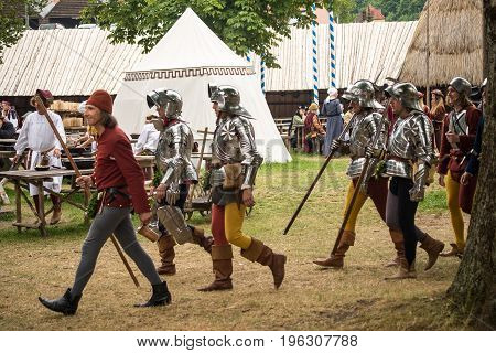 Landshut,Germany-July 15,2017:A group of bailifs walk by in the campgrounds