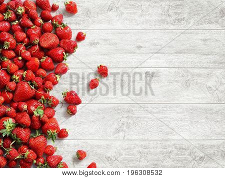 Healthy strawberry on white wooden background. Fruits diet concept. Copy space. Top view high resolution product