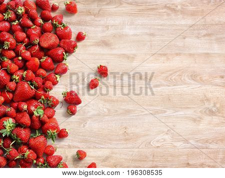 Healthy strawberry on wooden background. Fruits diet concept. Copy space. Top view high resolution product
