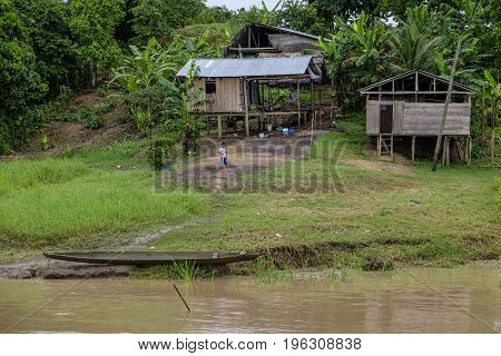 AMAZON RIVER PERU - 16 FEBRUARY 2016 - Children playing in typical wooden shack housing on the banks of the Amazon River in Peruvian rainforest