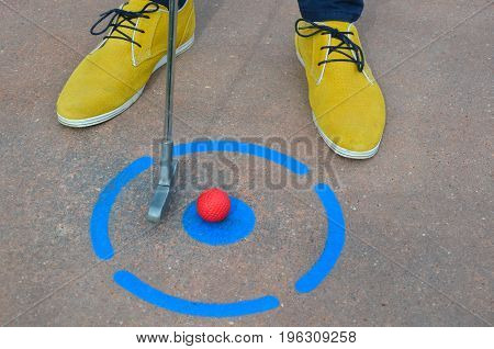 Mini Golf from the point with yellow shoes