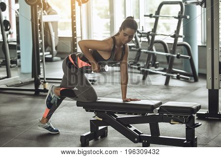 Young female exercise in the gym workout