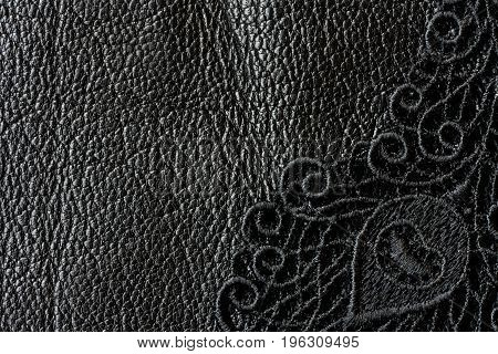 Detail of black lace on leather macro space for text