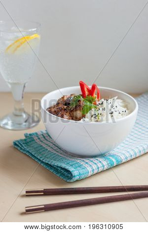 Vertical soft focus garlic pepper pork ribs with rice Asian style and fizzy drink