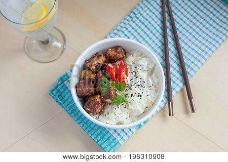 Horizontal soft focus garlic pepper pork ribs with rice Asian style and fizzy drink