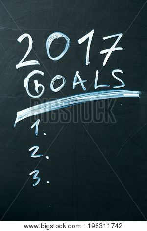 inscription 2017 goals it list drawn with chalk on a school blackboard dark.
