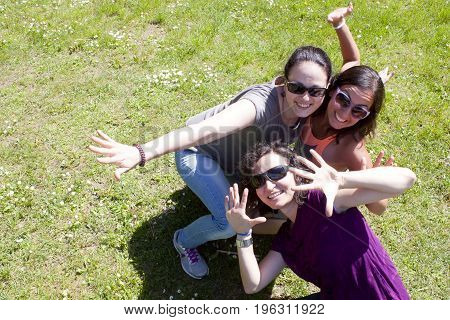Three Girls Having Good Time In A Sunny Day