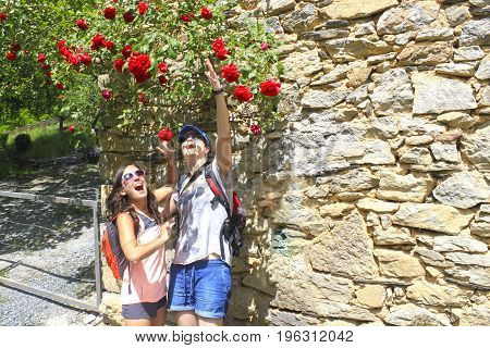 Two Women Enthusiastic With Some Flowers In Spring