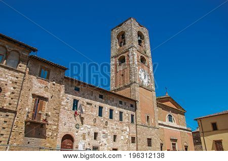Overview of old buildings and bell tower with clock at Colle di Val d'Elsa. A graceful village with its historic center preserved and known by its crystal production. Located in the Tuscany region