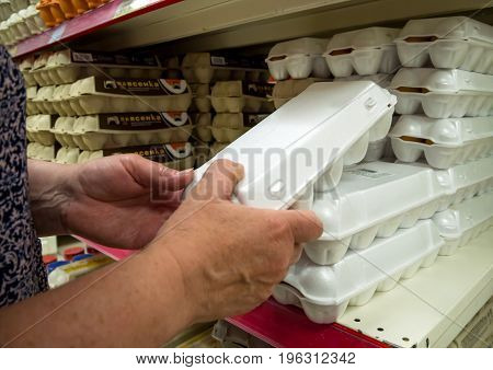 Voronezh Russia - May 26 2017: A tray with chicken eggs in the hands of a man