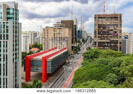 Avenida Paulista financial center of Sao Paulo and Brazil and the MASP seen from above with its commercial buildings and intense movement of people and cars