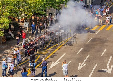 Zurich, Switzerland - 1 August, 2016: participants of the parade devoted to the Swiss National Day firing a shot signalizing the beginning of the parade. The Swiss National Day is the national holiday of Switzerland, set on 1 August.