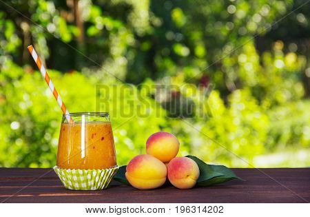 Homemade smoothies from juicy ripe apricots. Summer concept. Summer fruits and drinks.