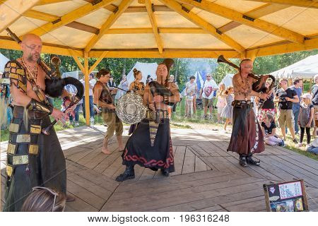 Useldange, Luxembourg, July 6, 2017. Cradem Aventure musicians stylized as the Goths performing on folk festival and playing bagpipes rock