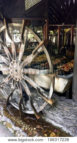 Baking lamb on a spit. Wheel rotates the barbecue.
